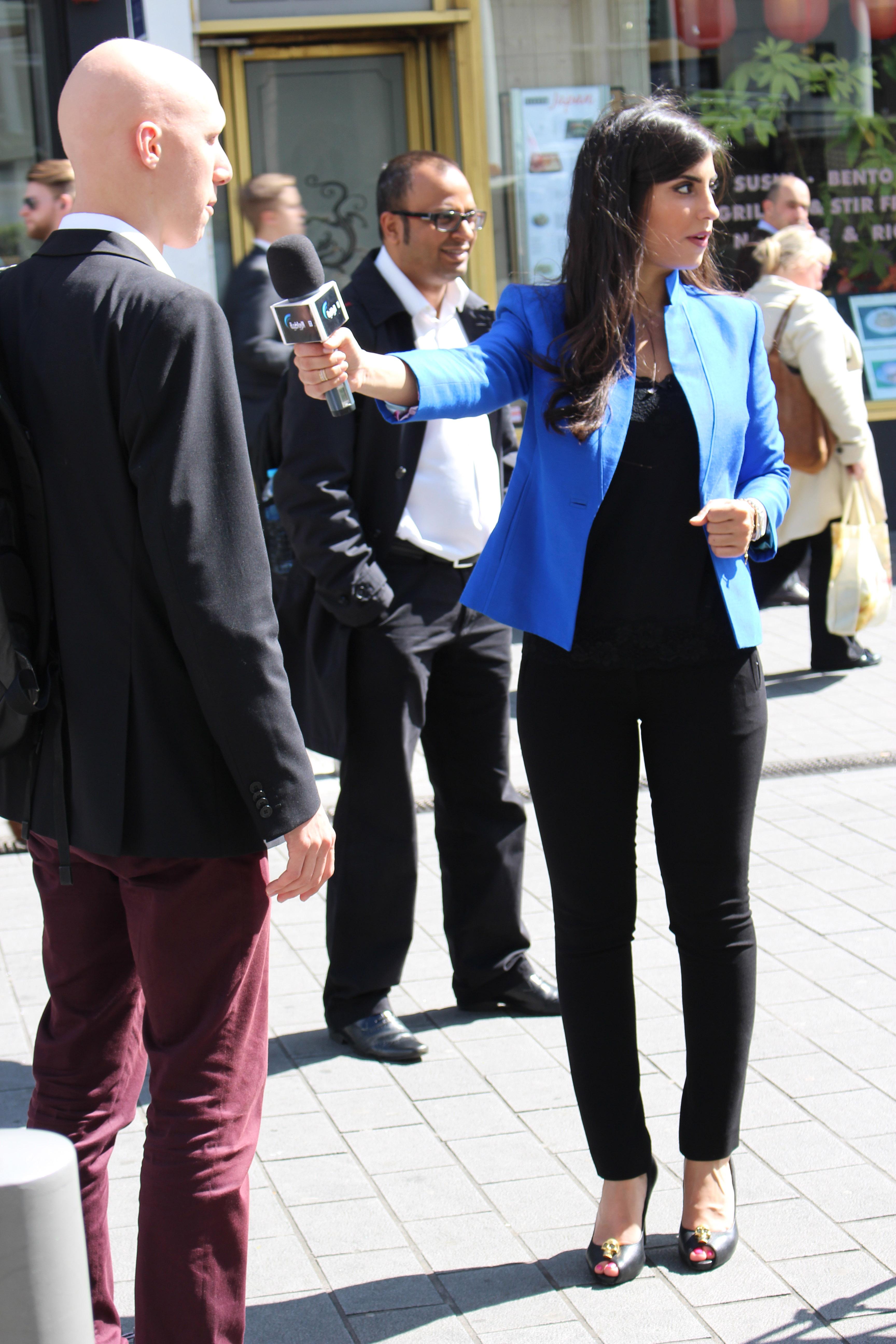 reporter in blue